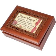 "The music box can hold a personal photo. Plays That's What Friends Are For when opened. Features: -Ornate collection. -Wood Grain finish. -Bronze feet. -Velvet lining. -Photo frame lid. Dimensions: -2.25"" H x 8.25"" W x 6"" D, 1.4 lbs."