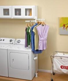 Shop for Appliances at The Home Depot. The adjustable clothes rack is a stand alone hanging bar that can easily attach to any washer or dryer, providing additional hanging space in the laundry room. This adjustable clothes rack allows you to conveniently hang garments straight from the washer or dryer. It is collapsible and removable for quick, easy storage. It assembles easily in less than 5 minutes with a Phillips screwdriver. The rotating arms pivot independently to accommodate various configurations. Extends up to 79 in. Hanger arms are 12-1/2 in. long. Requires 3 in. clearance side to side to enable rack to fit between the washer and dryer or between the rack and the wall. Maximum weight limit of 20 lbs.